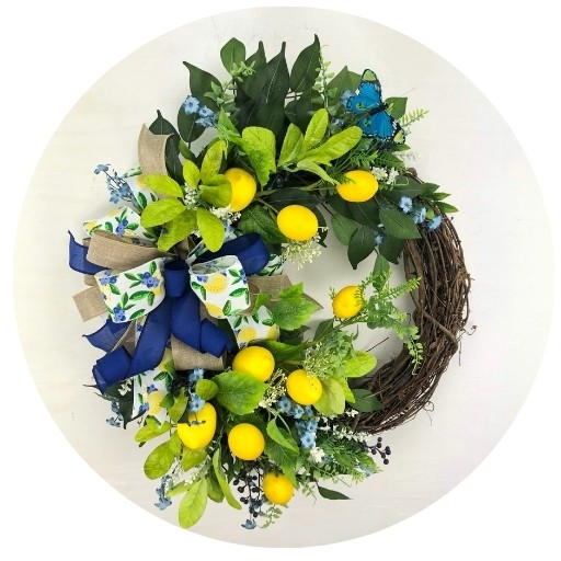 Door wreath with lemons, blue flowers and blue butterfly and matching yellow and blue ribbons